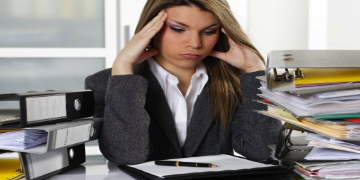 busy woman 3 Signs your business is taking over your life and how to quickly turn it around